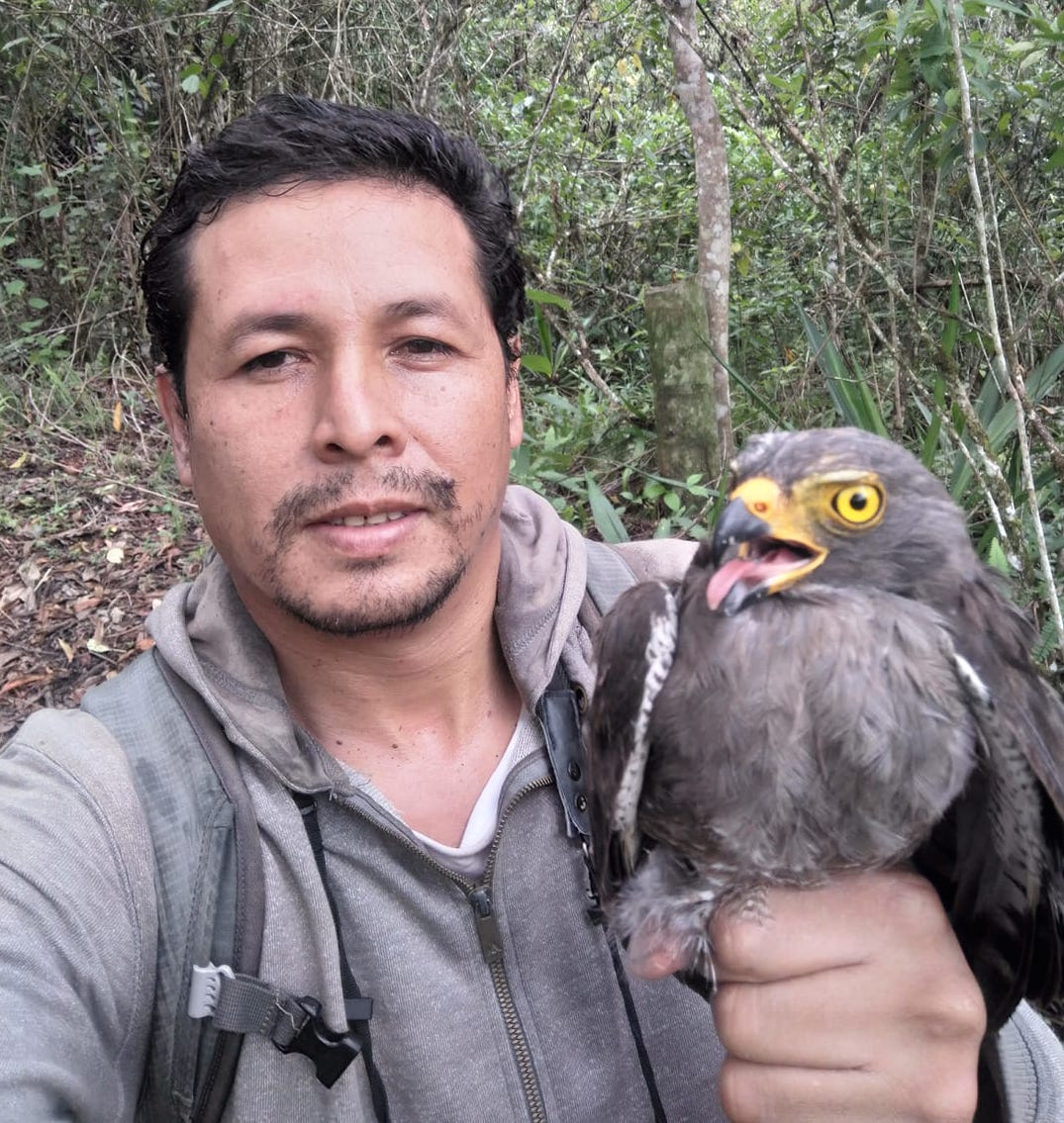 Luis Cueto holding a large raptor